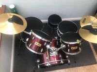 Red Cannon Drum Kit 5 piece set, plus cymbals with stool. Ideal for beginners
