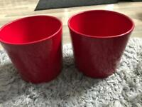 2 red plant pots