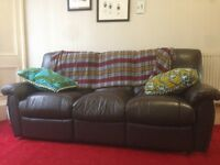 Brown leather reclining couch for sale