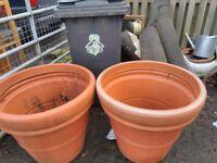 2 mega huge plastic planters/pots