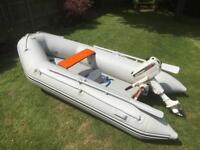 Wetline 290 inflatable dinghy with Johnson 4 HP outboard motor