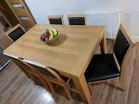Real oak veneer table with six chairs
