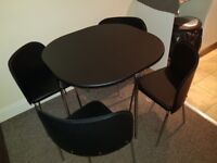 Table and chairs compact design