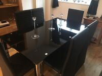Glass 6 seater dining table and 6 chairs