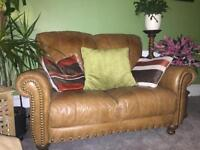 Swap - Distressed leather sofa for wing back chair