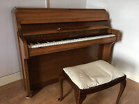 Royalette Piano and a stool