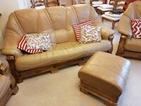 Beige leather sofa and 2 chairs with pouffe