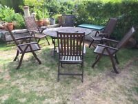 Large Oxford garden teak table and 6 Reclining chairs