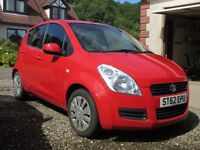 Suzuki Splash SZ2 5 dr. Bright Red. Dec 2012. One owner. Very Good Condition.