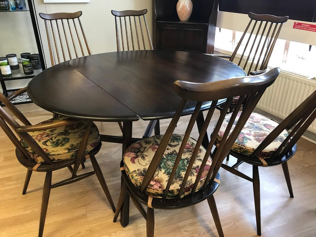 ERCOL DINING TABLE AND SIX CHAIRS WITH ORIGINAL SEAT PADS