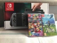 Boxed Nintendo Switch with two games and accessories