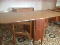 Dining table with drop down sides and internal storage space idea for smaller rooms