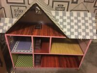 Wooden dolls house nearly new with accessories.