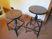 TWO WOODEN SEATED SWIVEL STOOLS