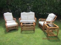 Conservatory Furniture, Wicker frame with cream covered cushions.