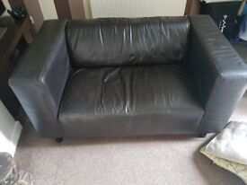 Faux leather two seater sofa