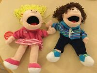 2 Hand Puppets- Fiesta Girl and Fiesta Boy with moving mouths.