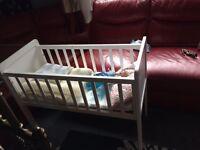 White baby's crib with matress