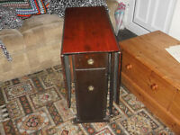 For sale a drop leaf cabinet table