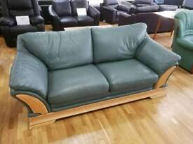 Green leather 3 seater sofa with pine wooden trim