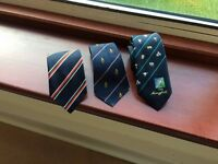 Three pristine ties affiliated to all rugby players and firemen