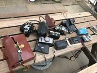 Assortment of old cameras and lenses