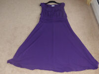 Beautiful purple occassion dress would fit 16/18 as new never worn