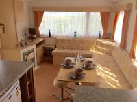 Cheap 6 berth caravan sited on nice pitch on beautiful seaside holiday holiday park in mid- wales