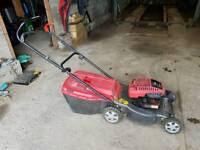 Petrol mower with drive