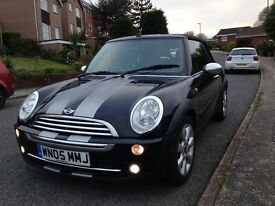 Stunning looking Mini Cooper Convertible in black with silver stripes