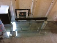 Glass TV stand and Samsung wireless surround soundbar with speaker