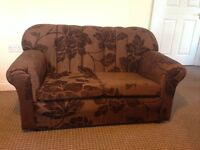 Stylish 2-Seater Sofa, brown with a flourish pattern