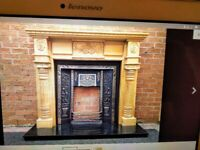 Reduced! - Cast iron fireplace insert and black marble hearth.