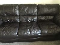 Three piece brown leather suite plus storage footstool. Good condition