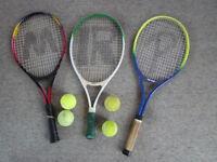Three tennis racquets