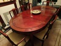 8 seater rosewood dining table and chairs
