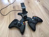 2 Controllers for Xbox 360 with battery packs and charger.