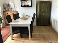 Large Barker and stonehouse dining room table and six chairs
