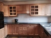 Fitted kitchen with dishwasher, oven, extractor, sink and worktops