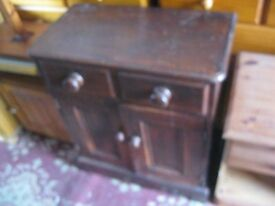 VERSATILE SOLID STAINTED PINE SMALL CABINET. IDEAL AS IS OR PAINTED. VIEWING/DELIVERY AVAILABLE