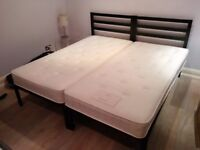 Two single bed frames and mattresses