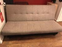 Grey and black material sofa bed with storage