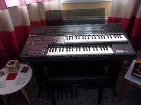 Farfisa electronic keyboard and stool