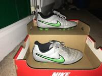 Grey an green Nike football boots