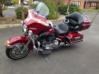 Harley Davidson Electro Glide FLHTCU. Immaculate, very low milage, extensive chrome, custom paint.