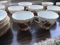 Set of 12 fine bone China cups and saucers including sugar bowl and milk jug