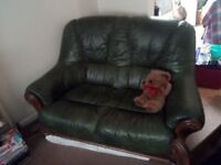 Green leather and solid wood two seater sofa and two armchairs