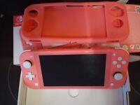 Nintendo switch lite console coral