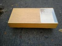 Coffee table side unit with glass and a sliding storage drawer