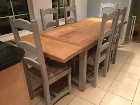 Solid Oak dining table and 6 chairs . Vintage/ country style.